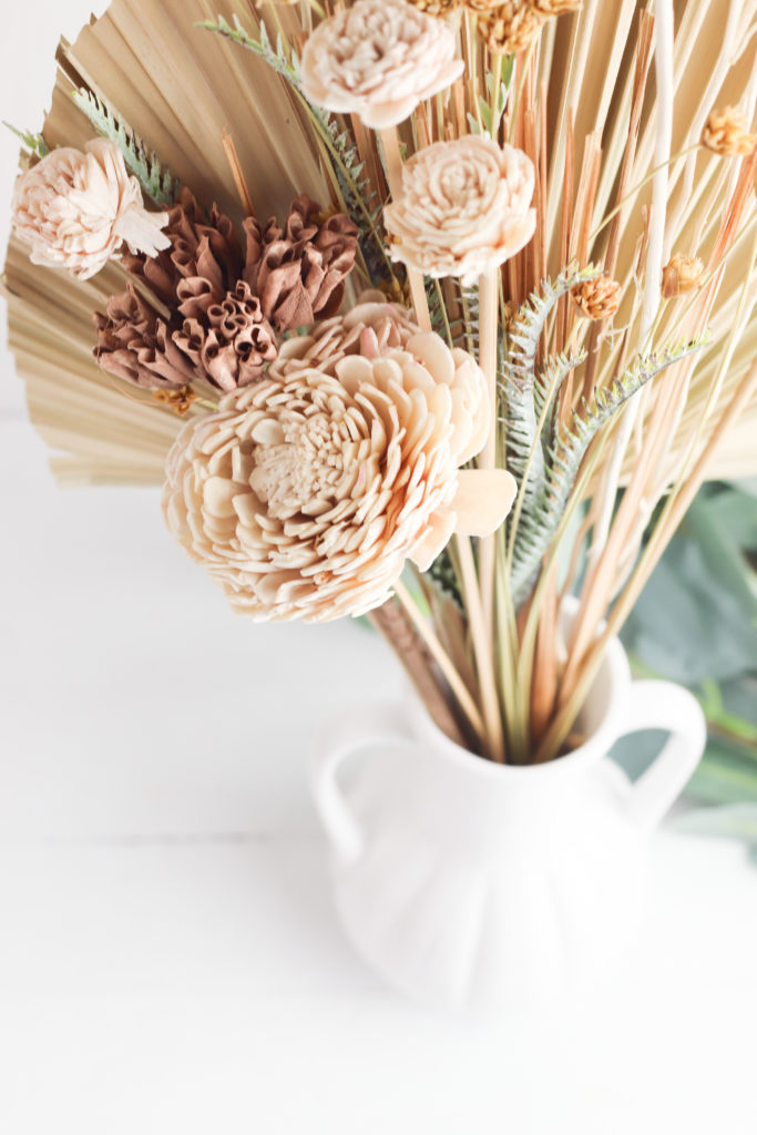 Close up view of the dried palm leaf bouquet.