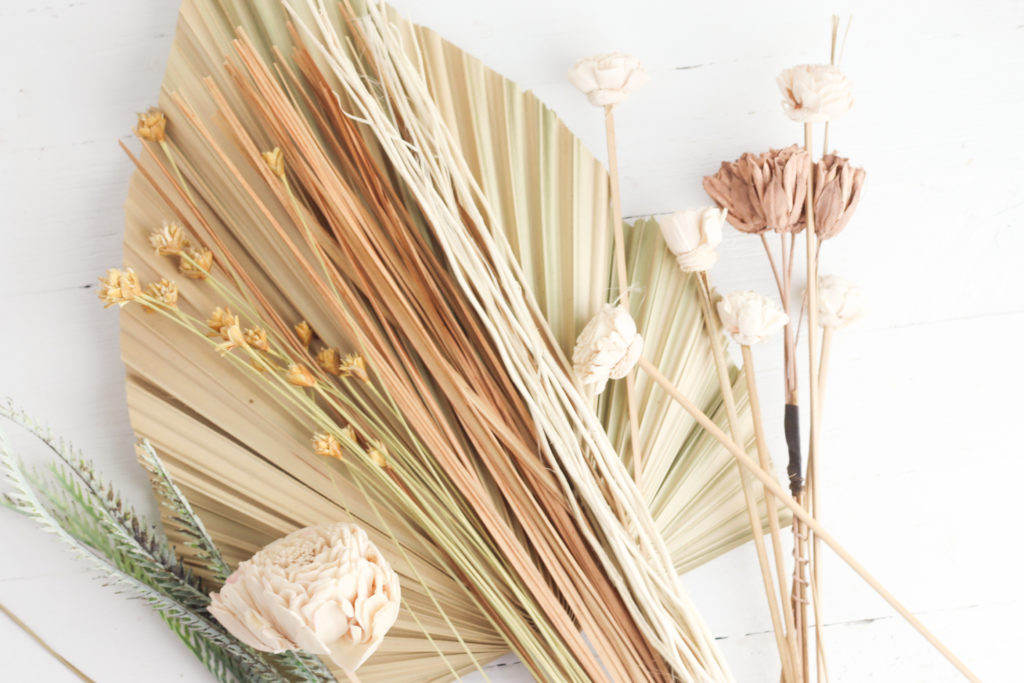 Materials needed to make a dried palm leaf flower arrangment.