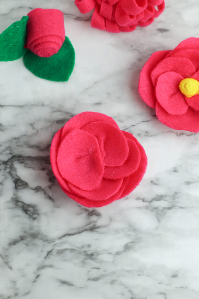 Layering the felt pieces together to form the petals.